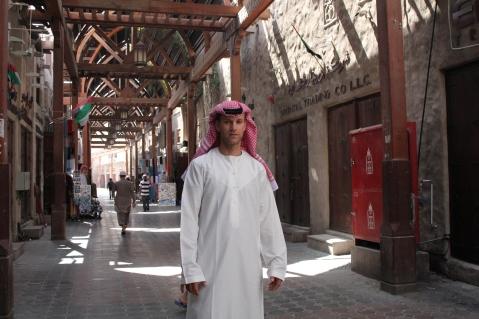 Michel dressed in a dishdash (white robe) and a  Keffiyeh (head scarf).